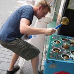 Time for supply chain optimization, man playing whack a mole